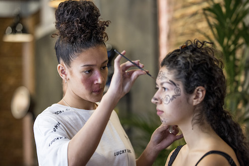 Ryley Isaac applying make-up to model/performer on Glow Up