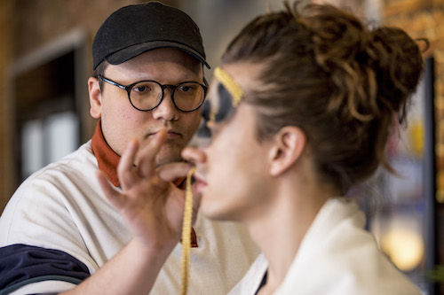 Xavi Guillaume applying make-up to model/performer on Glow Up