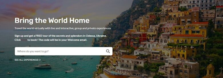Beeyonder virtual travel website homepage showing an image of a coastline and houses cut into the mountains