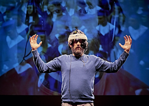 Man on stage wearing hat - Louder is not always clearer - BBC Arts