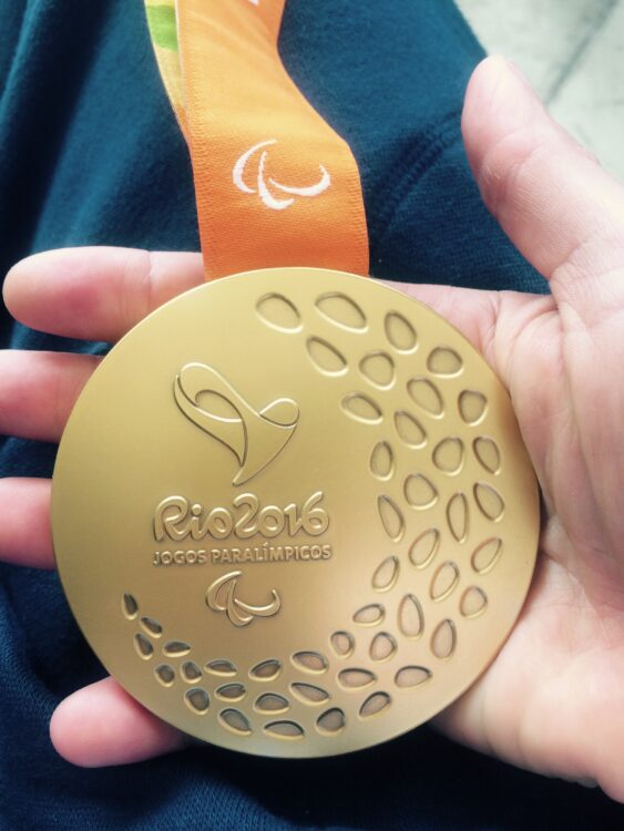Emma Wiggs holding Gold Medal that she won at Rio 2016 Paralympic Games