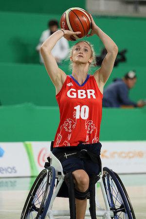 Amy Conroy playing wheelchair basketball