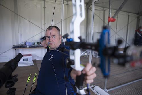 John Stubbs using his bow and arrow