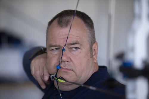 John Stubbs looking through his bow