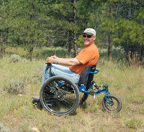 TJ Woosley on his Mountain Trike all-terrain wheelchair in a forest in the USA