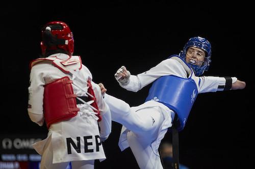 Beth Munro competing in taekwondo