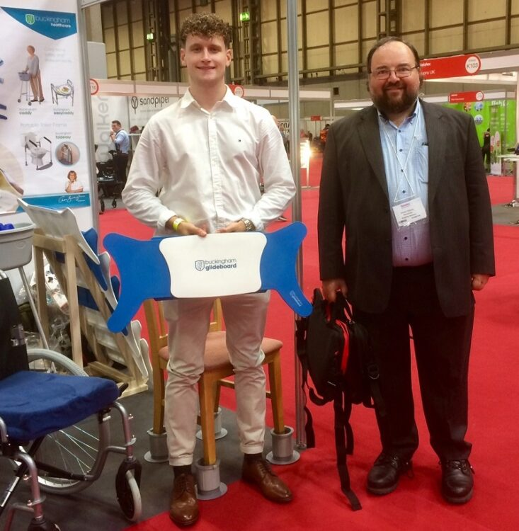 Disability Horizons Shop manager Duncan Edwards with Bradley Buckingham at Naidex launching the Glideboard