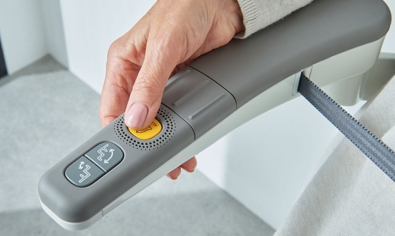 Flow X stairlift armrest controls with a big yellow button