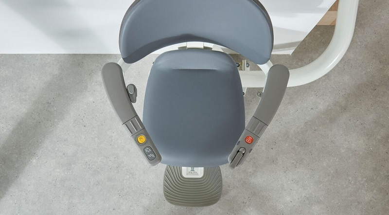 Flow X stairlift seat seen from above with armrests