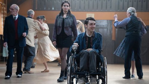 Maeve stood next to Isaac in his wheelchair on Sex Education