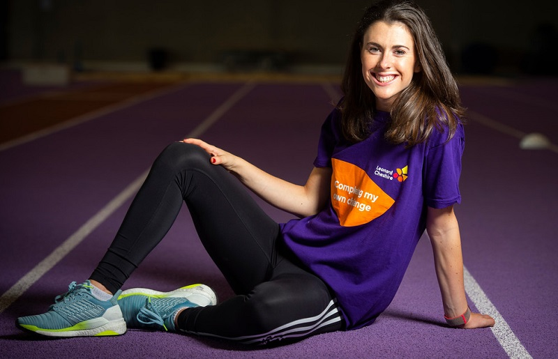 Paralympian Livvy Breen sat on a race track smiling