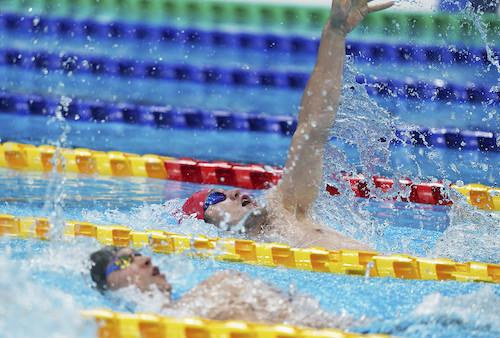 Reece Dunn cheering in the swimming pool