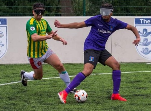 Azeem wearing a blindfold playing blind football