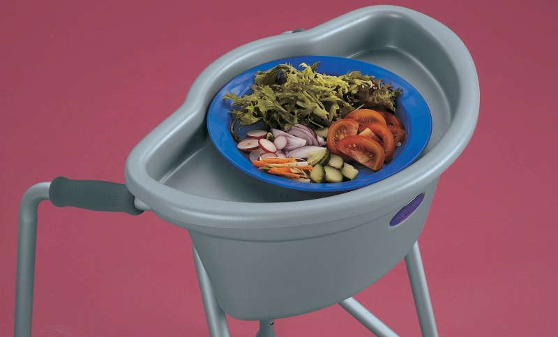 Buckingham Healthcare walking frame caddy with a tray to carry food